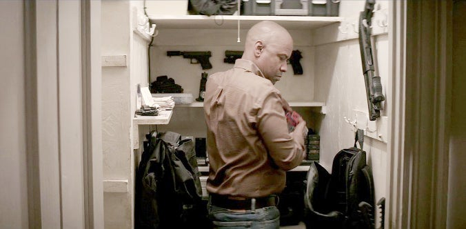 We get a quick look at the hidden arsenal in McCall's home.
