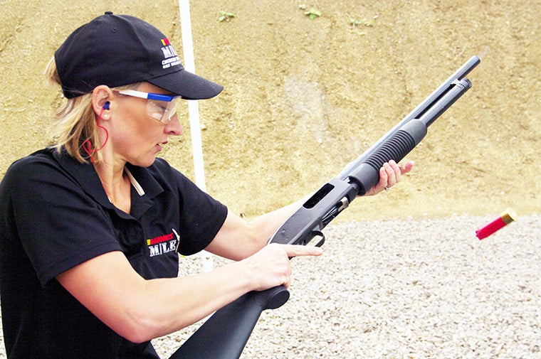 Jessica Brooks shooting a Mossberg shotgun