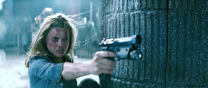 Ferris (Keri Russell) fires Hunt's Beretta 92G Elite 1A pistol during the beginning rescue sequence.
