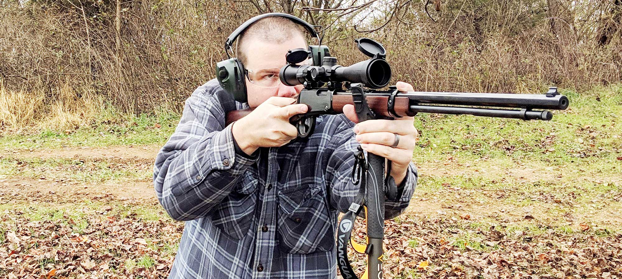 man using vanguard veo 2 shooting sticks