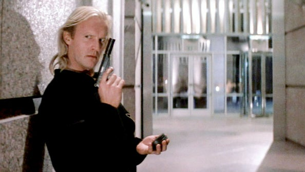 When the terrorist enter the Nakatomi building, Karl (Alexander Godunov) uses a suppressed Walther PPK to kill the security guards on the lobby floor. He can also be seen carrying the pistol with the