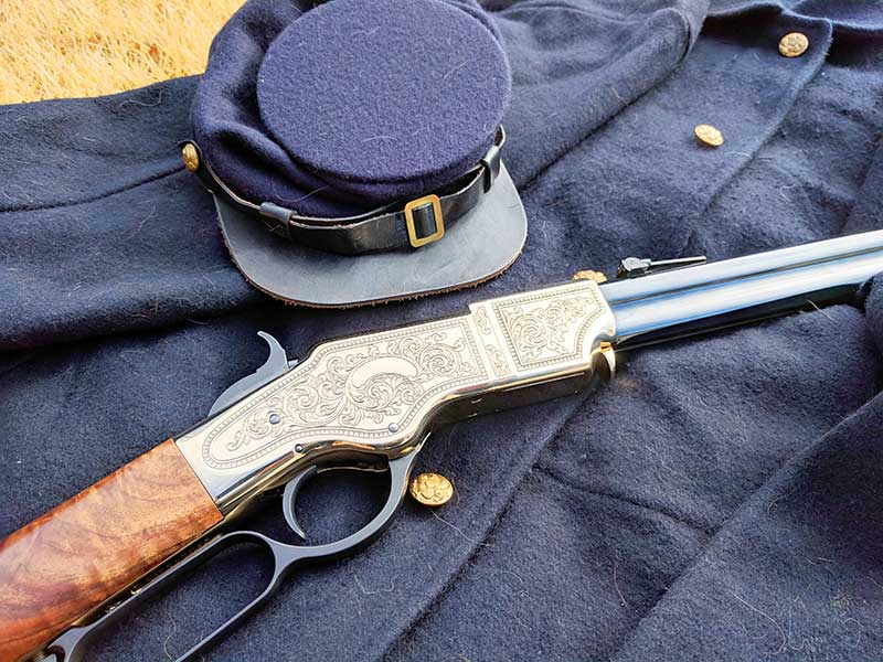 henry deluxe engraved rifle and military uniform