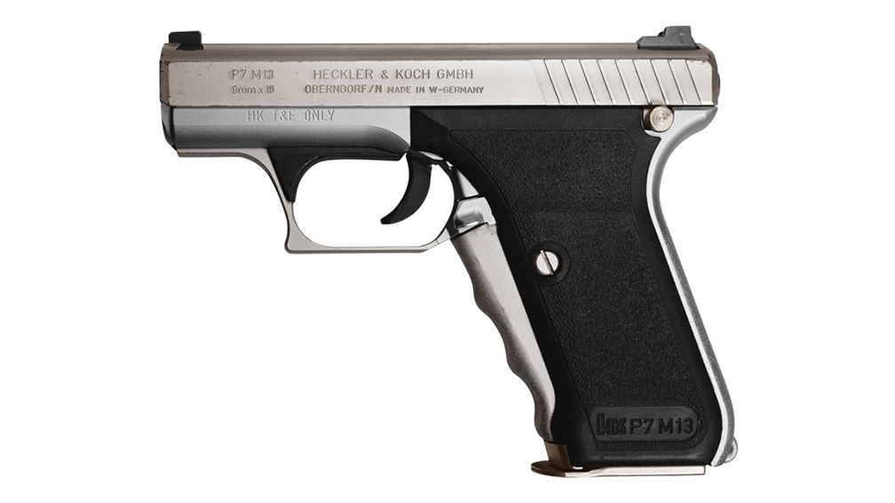 The Heckler & Koch P7M13 has a distinctive cocking lever built into the front of the grip.