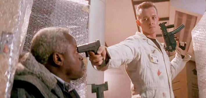 A young Robert Patrick as one of Col. Stewart's henchmen, holds a Glock 17 and an MP5SK.