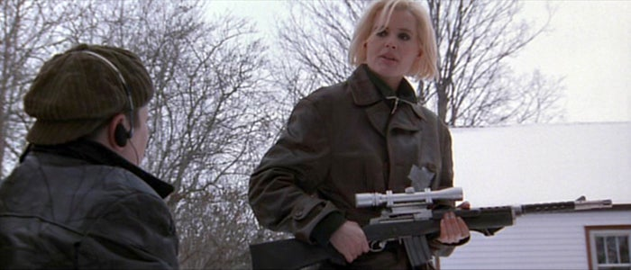 Charly with her scoped Ruger Mini 14 carbine.