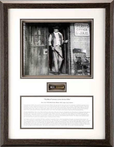 framed bullet and image of john wayne