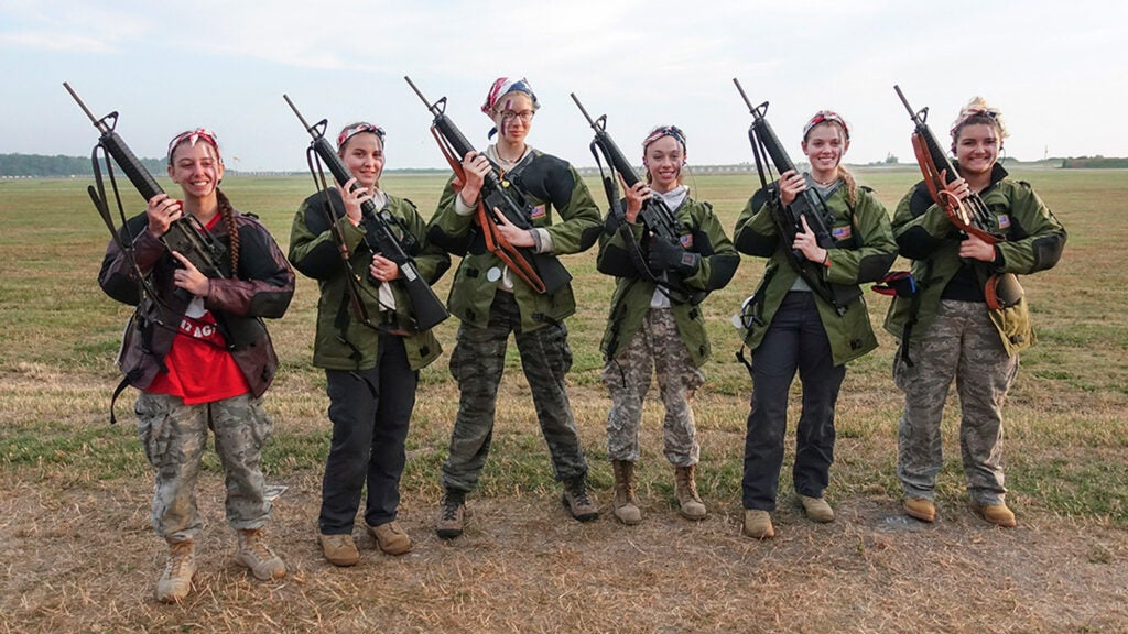 The team with their rifles at the competition.
