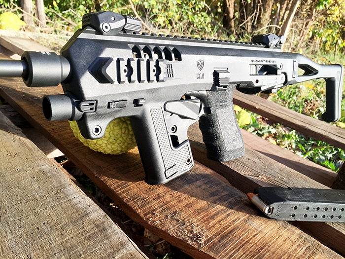 The Micro Roni wearing flip-up front and rear sights.