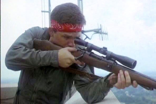 Whitman (Russell) begins his rampage from atop the tower with a sporterized Arisaka Type 02 paratrooper takedown rifle.
