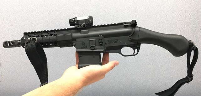 The Raider is pictured here with a 20-round PMag inserted, a muzzle brake on the threaded barrel and a sling attached to the Raptor grip.