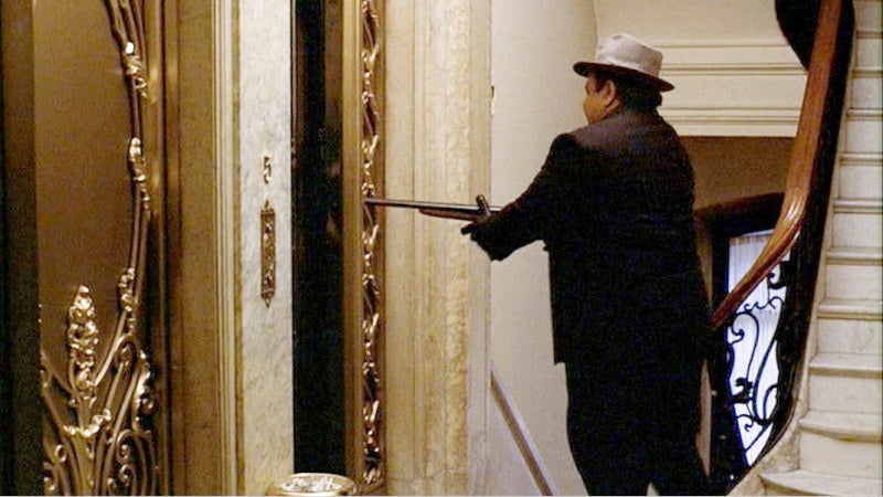 Clamenza blasts Stracci and his men inside of an elevator with a shotgun.