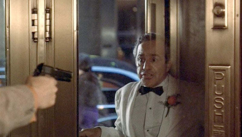 Willi Cicci uses an M1911A1 to kill Don Cuneo while trapped in a revolving door.