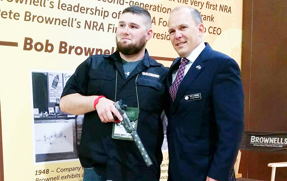 """""""FedEx Guy"""" Honored by Brownells With One-Of-A-Kind Pistol"""