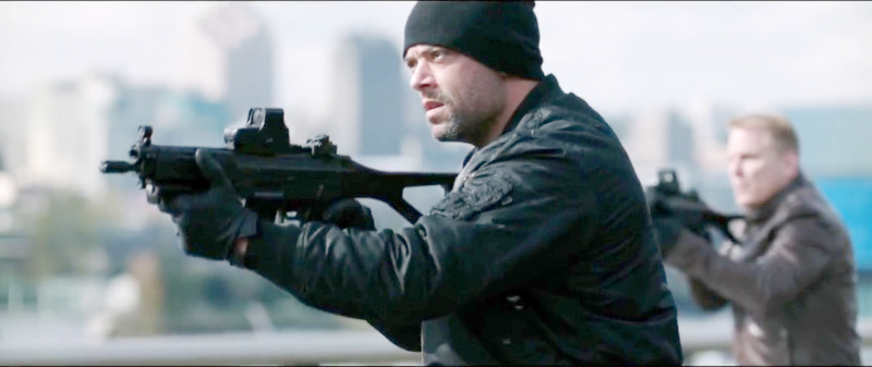 A bad guy on the bridge with an FN SCAR-L.