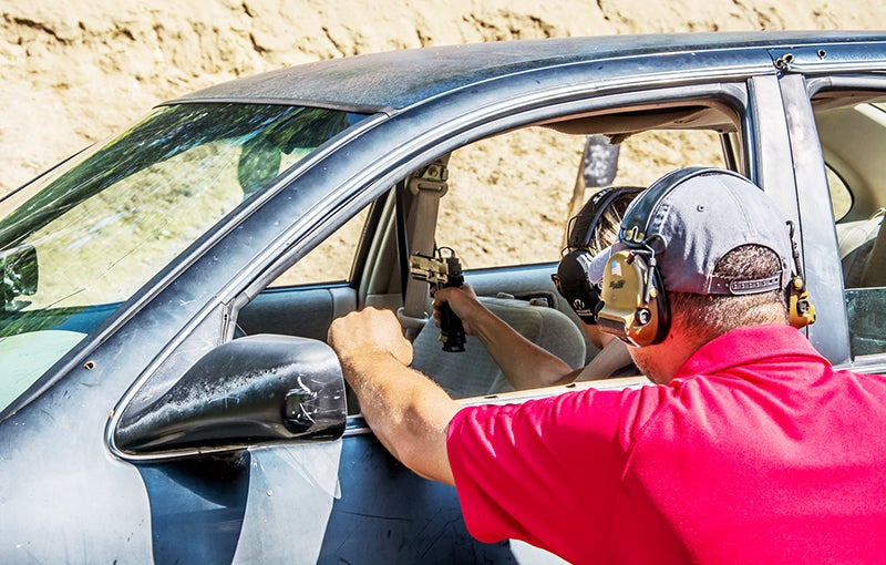 There were even pistol courses that required shooters to fire while seated in a vehicle with the seatbelt buckled, and through and around cars using them for cover and concealment.