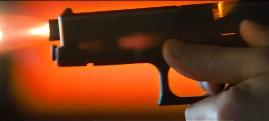 A close-up from the trailer of the Glock firing as Kersey practices.