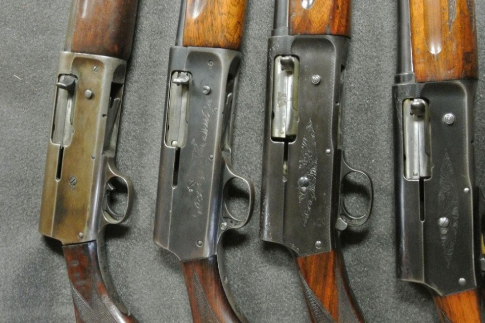 From left to right: Early Remington Model 11 12-gauge with the original style safety, later Remington Model 11 in 20-gauge, Browning Auto 5 in 12-gauge magnum, and a Browning Auto 5 in 20-gauge.