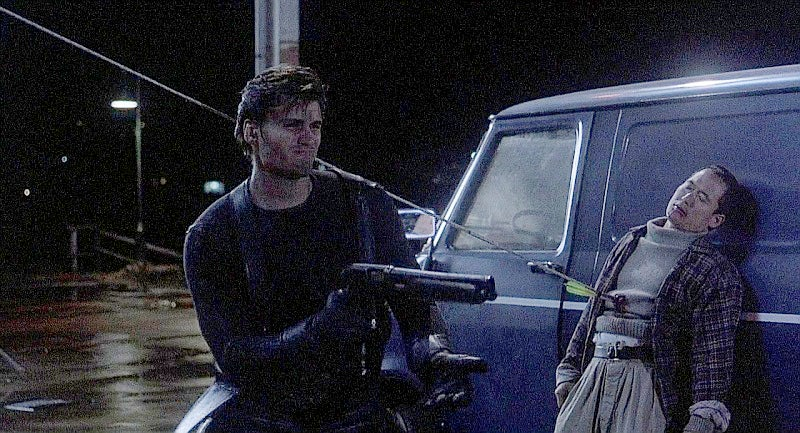 Castle fires his shotgun after zip-lining onto the docks.