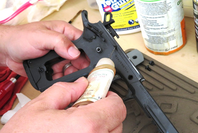 The receiver/frame, on a general field strip, will have oil sparingly applied in a very thin line down each rail of the receiver/frame.