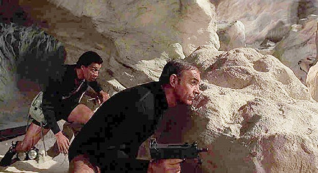 Bond takes cover with his MAC-10.