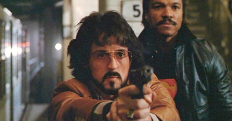 Deke DeSilva (Stallone) aims his M1911A1 in the subway at a fleeing terrorist.