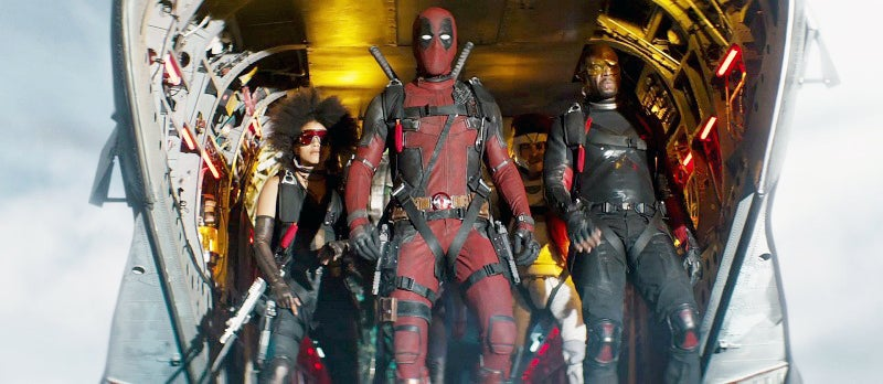 Deadpool carries his twin Desert Eagle XIX pistols in a double thigh holster rig. Each of those guns weighs over 4.5 pounds EMPTY, so that's one serious gunbelt.
