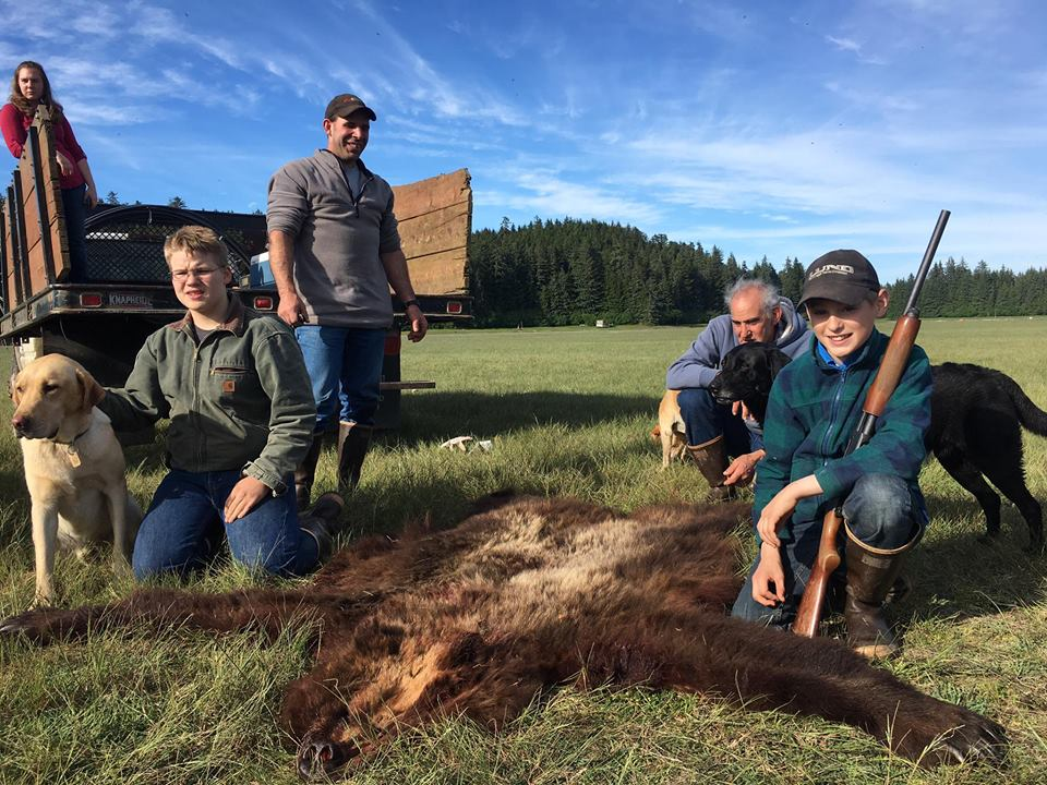 Another shot of Elliot and family with the skin of the bear that almost killed them.