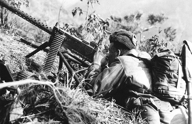 A U.S. soldier takes aim with a tripod-mounted M1919A4 in Korea, 1953.