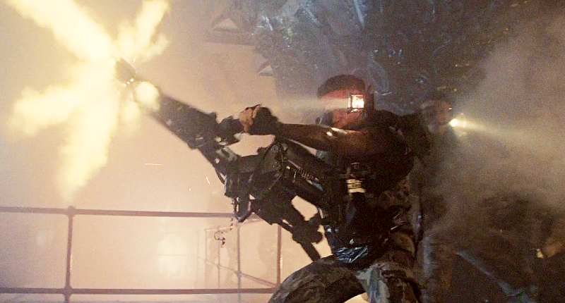 While the rig for the M56 Smart Gun from *Aliens* (1986) was built from a Steadicam rig, it functioned in much the same way as the third-arm device being tested by the U.S. Army right now. The movie g