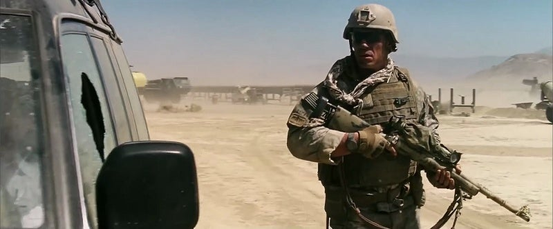 Matthews carrying his M24 as he investigates the bodies in the vehicle.