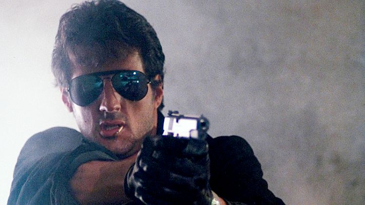 Stallone as Lt. Marion Cobretti with his custom Colt Gold Cup National Match 1911 in 9mm.