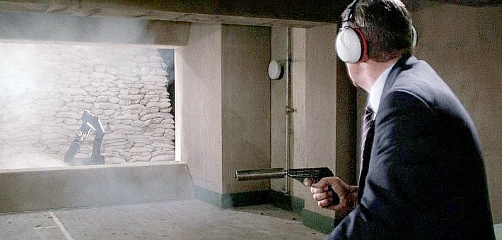 Bond uses a suppressed Mauser HSc at the firing range, which was likely chosen because of its visual similarity to the PPK.