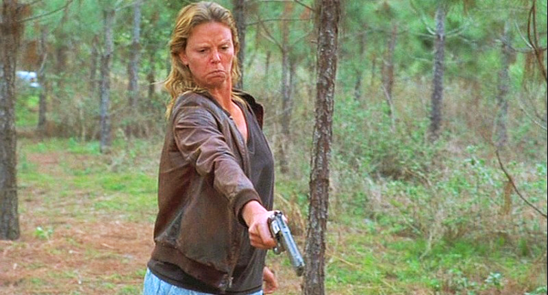Theron as serial killer Aileen Wournos with an S&W Model 617 in .22LR.