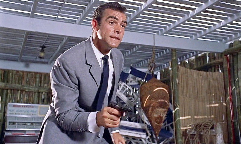 Bond (Sean Connery) pointing his Walther PP in *Dr. No*.