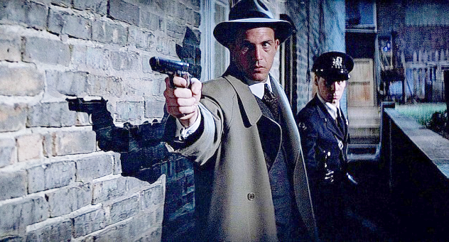 Kevin Costner in The Untouchables aims a Star at a gangster in a dark alleyway. [photo from imfdb.org](http://www.imfdb.org/wiki/Main_Page)