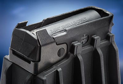 A close look at the feed lips and follower on the Mossberg magazine.
