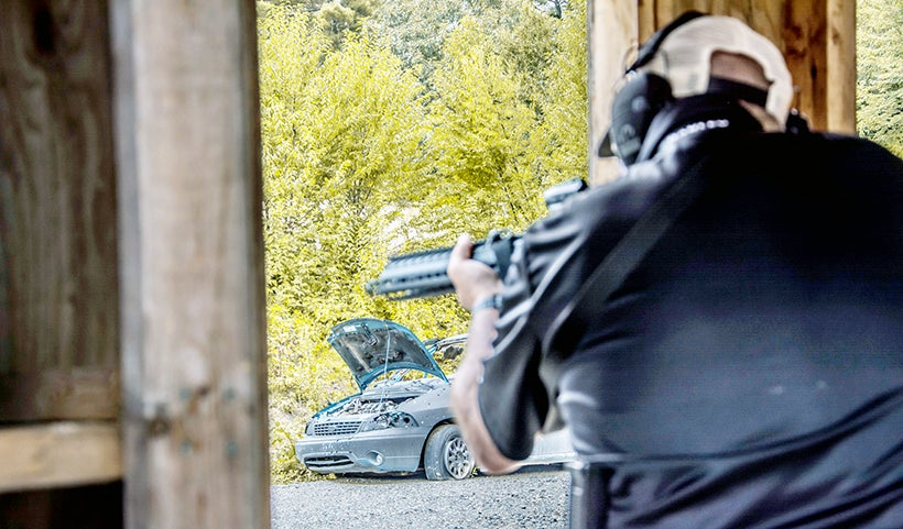 A shooter fires from the window of the shoot house.