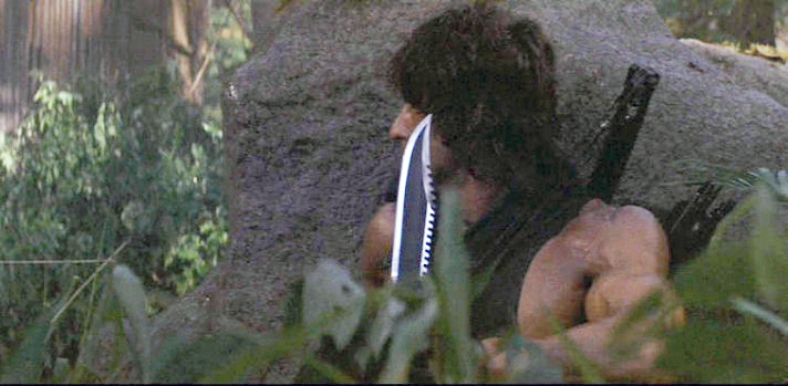 Rambo with his survival knife, again designed by Jimmy Lile based on the *First Blood* knife.