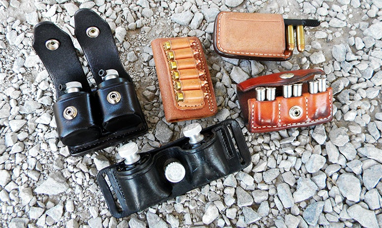 Options for packing extra ammo for the revolver: HKS speedloaders (in black pouches), a simple six round belt pouch, a speed strip and pouch, and the 3x2 pouch