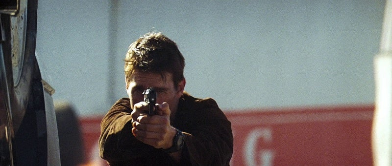 Hunt fires his Beretta 92G Elite 1A without the gun light attached during the bridge assault.
