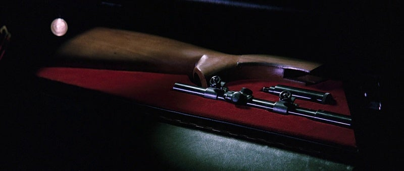 A disassembled AR-7 in Bond's glove compartment.