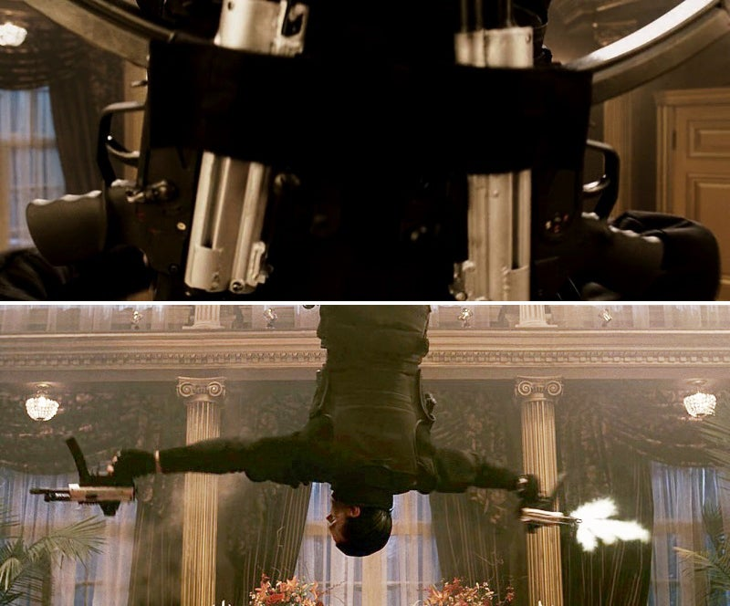 Castle fires both MP5SK submachine guns while hanging upside down on a rope at the mob dinner.