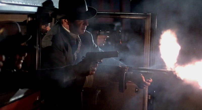 Though it's hard to see, that's Stallone as Frank Nitti in the background firing a Star Model B pistol.