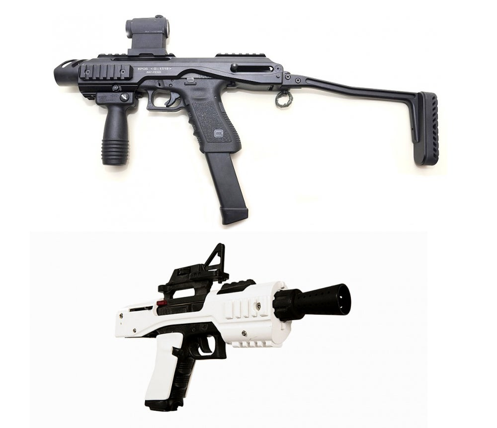 The black and white Sonn-Blas SE-44C Blaster Pistol prop was based on a Glock 17 in a FAB Defense KPOS carbine conversion kit with the stock removed.