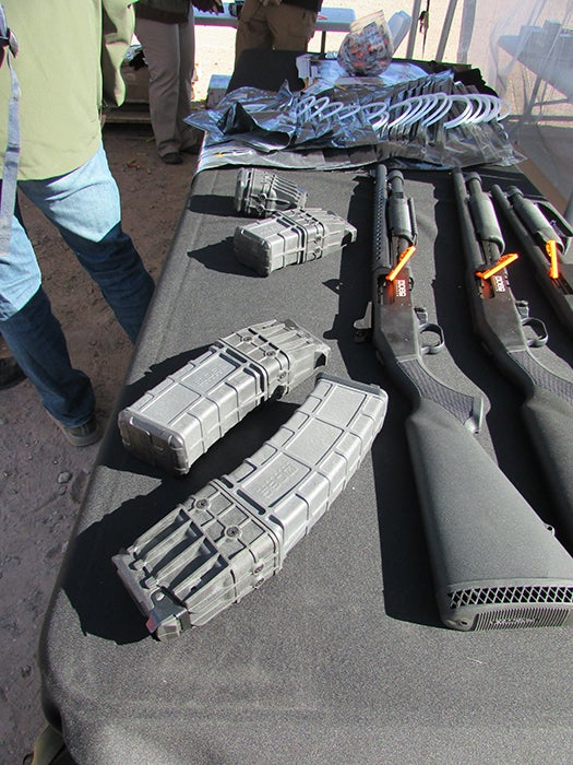 The Mossberg 590M at Range Day with its various magazines.