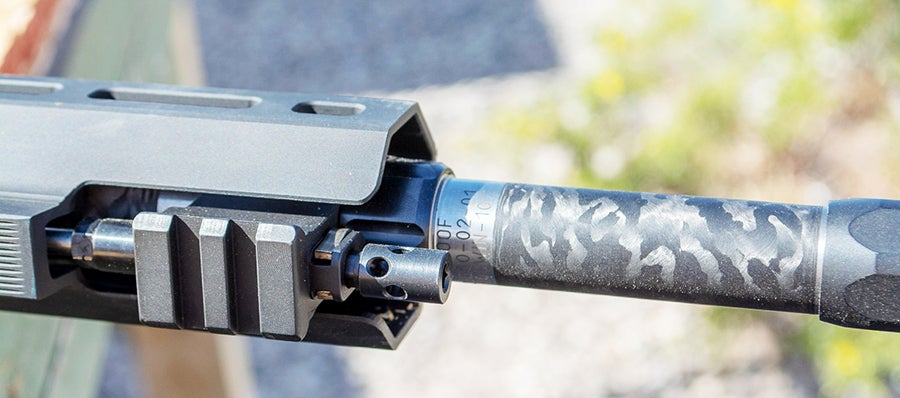 The carbon-fiber-wrapped barrel and adjustable gas system just forward of the hand guard.