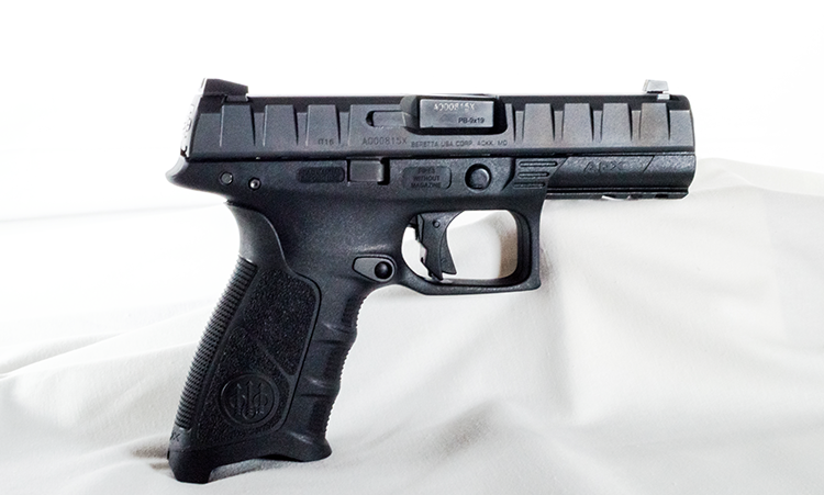 Right-side shot of the Beretta APX. Note the subtle finger grooves and slightly flared magwell.