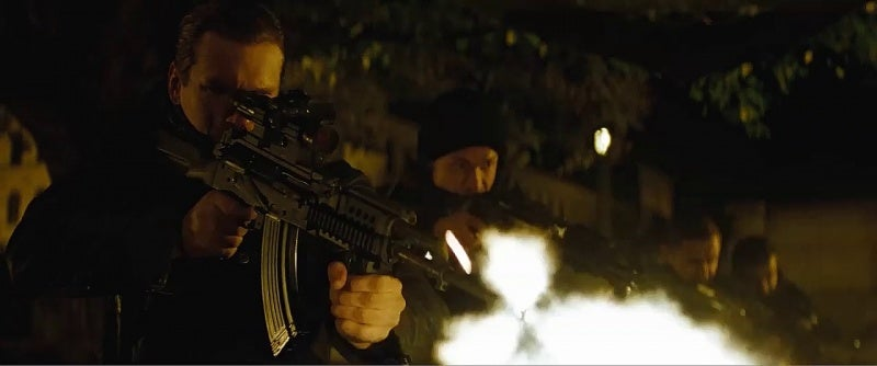 A Russian operative in Moscow fires a customized AKM rifle.