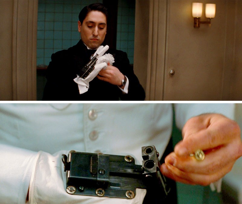 Omar and Donny use .38-caliber OSS Pistol Gloves to take out two German guards in the theater.