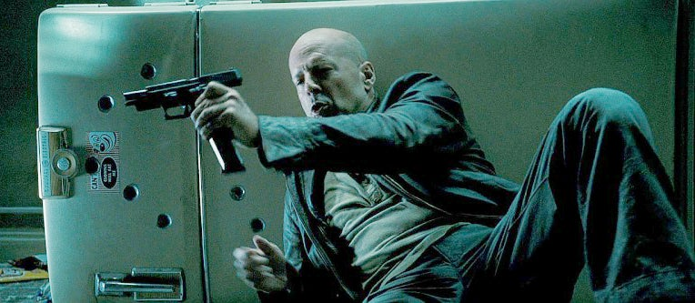 McClane reloads his SIG in while taking cover behind a refrigerator.